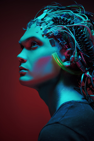 Portrait of a cyborg looking up over red background. Biological human robot with wires implanted in the head. Technologies of the future.