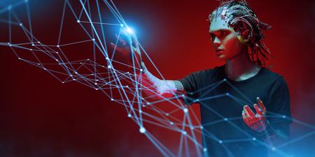 Cyborg man is surfing in cyberspace. Digital network connection. Virtual reality games. Zdjęcie Seryjne
