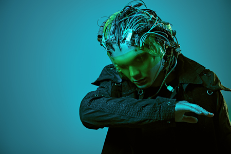 Cyborg. Biological human robot with wires implanted in the head. Technologies of the future. Copy space. Zdjęcie Seryjne