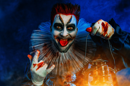 A portrait of an angry crazy clown from a horror film. Halloween, carnival. Reklamní fotografie