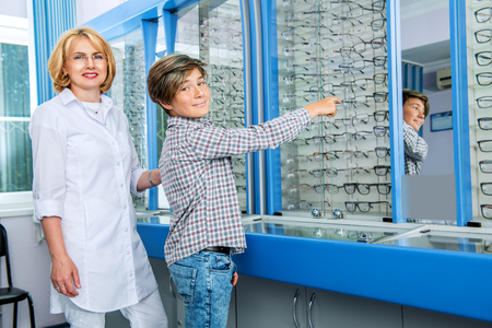 An eye doctor and a teenage boy. Optics, vision, healthcare. Stok Fotoğraf