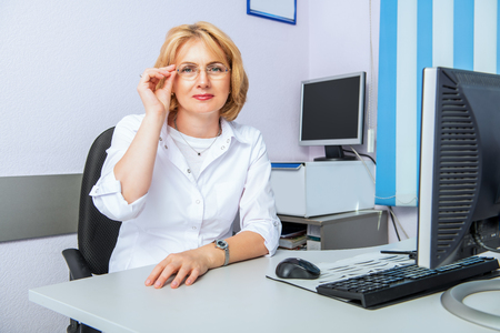 A portrait of a female oculist in the cabinet in a clinic. Optics, healthcare. Stok Fotoğraf