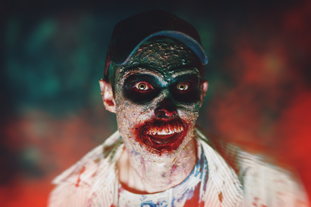 Portrait of a horrible scary zombie man. Horror. Halloween.