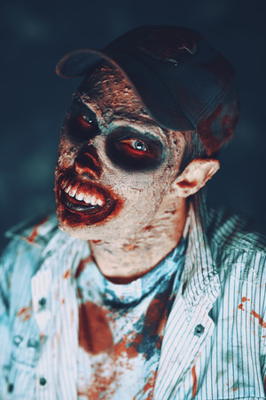 Portrait of a horrible scary zombie man. Horror. Halloween. 写真素材 - 130395212