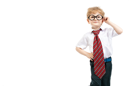 A portrait of an emotional funny young schoolboy posing in the studio over the white background. Kids fashion for school, education.