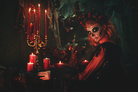 Day of The Dead. Charming and dangerous Calavera Catrina in an old abandoned house. Sugar skull girl. Dia de los muertos. Halloween. Stock Photo