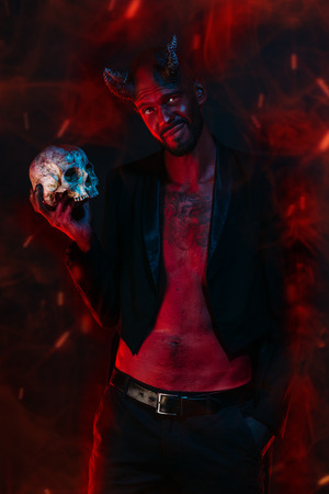 A portrait of a bad demon with a skull. Horror movie, nightmare. Halloween. 写真素材 - 130894175