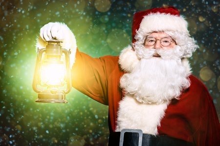 A portrait of Santa Claus holding a lantern. Merry Christmas and Happy New Year!