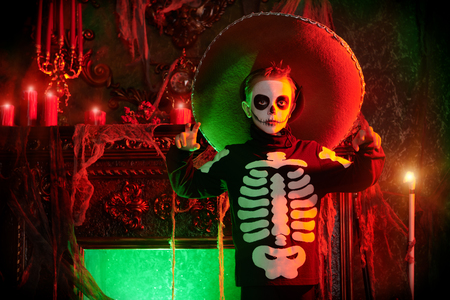 Sugar skull child boy in an old magic castle. Dia de los muertos. Day of The Dead. Halloween. Fairy tales. Childrens horror stories.