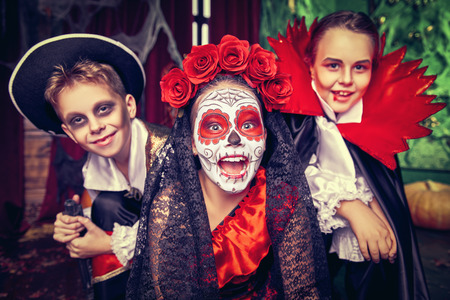 Happy children celebrate Halloween on a party with old castle decorations. Halloween. Archivio Fotografico