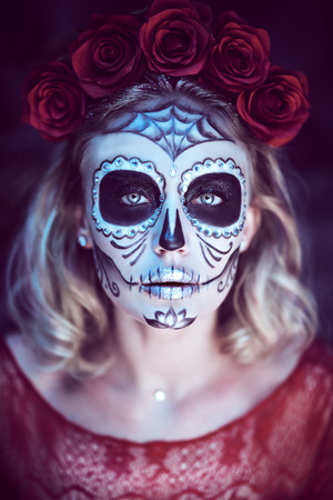 Sugar skull girl. Day of The Dead. Dia de los muertos. Charming and dangerous Calavera Catrina in an old abandoned house.  Halloween.