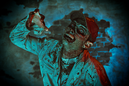 Scary bloodthirsty zombie man in a ruined building. Horror. Halloween. 写真素材 - 130995287