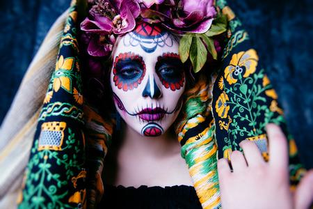 Closeup portrait of Calavera Catrina. Young woman with sugar skull makeup. Dia de los muertos. Day of The Dead. Halloween. Stock fotó