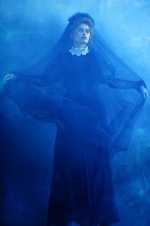 Portrait of a Victorian woman in mourning. Black widow in an atmosphere of mystery and mysticism. Halloween.