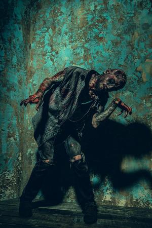 A portrait of a creepy scary zombie. Halloween. Horror film. Standard-Bild