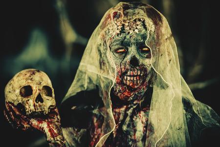 Portrait of a bloody dead bride woman. Zombie bride. Halloween. Horror.