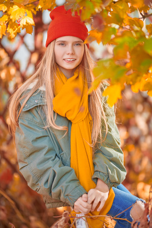 Autumn season. Portrait of a beautiful smiling girl teenager on a sunny autumn day. Stok Fotoğraf