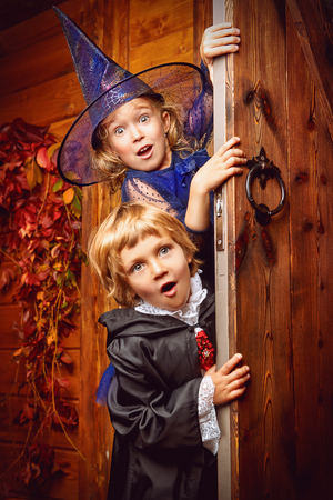 Happy children in witch and vampire costumes celebrate halloween. Trick or treat. Halloween. Stok Fotoğraf