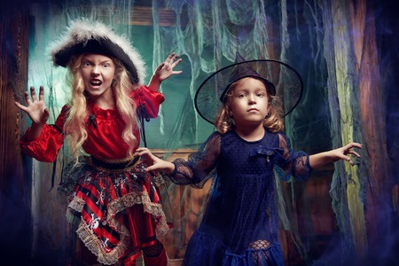 Halloween tales. Funny children in carnival costumes celebrate halloween. Adventures in an old castle. Stok Fotoğraf