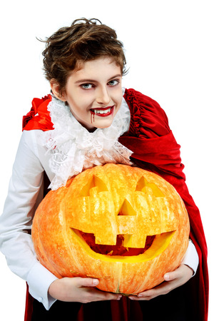 Portrait of a boy dressed in a costume of a vampire over white background. Halloween party.