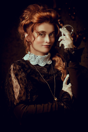Portrait of a beautiful Victorian woman. The history of hairstyles and makeup. Victorian, Baroque era style.