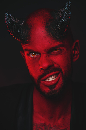 A close-up portrait of a bad demon. Horror movie, nightmare. Halloween.