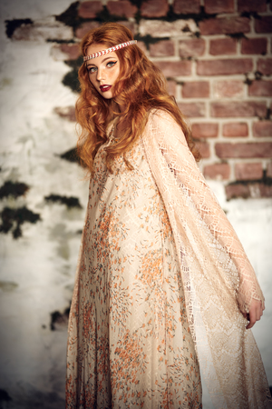 Portrait of a beautiful red-haired girl dressed in modern boho style. Beauty, fashion.