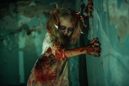 A portrait of a scary zombie girl. Halloween. Horror film. Archivio Fotografico