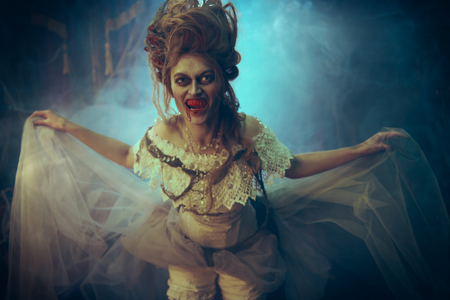 Vampires. Bloodthirsty female vampire in the old abandoned castle. Vintage style. Halloween.