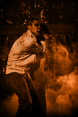 Zombies risen in the night cemetery. Halloween. Thriller. Sepia.