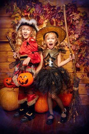 Halloween party. Joyful kids celebrate Halloween with fun. Halloween decorations with pumpkins.