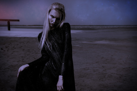 Portrait of a beautiful gothic woman in black clothes posing outdoor. Beauty, fashion.