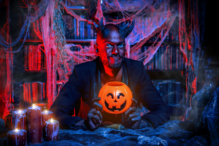 A portrait of a bad demon in his den. Horror movie, nightmare. Halloween.