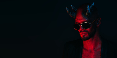 A portrait of a bad demon in sunglasses. Horror movie, nightmare. Halloween. 写真素材 - 132874194