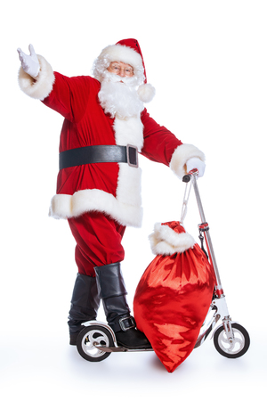 A portrait of Santa Claus with a scooter and a gift bag. Merry Christmas and Happy New Year!