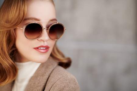 Modern business woman in formal clothes and sunglasses. Beauty, fashion. Optics and eyewear style. Copy space.