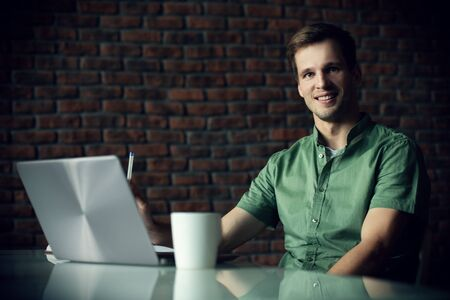 A happy man at office. Work and business. Workplace. Stock fotó