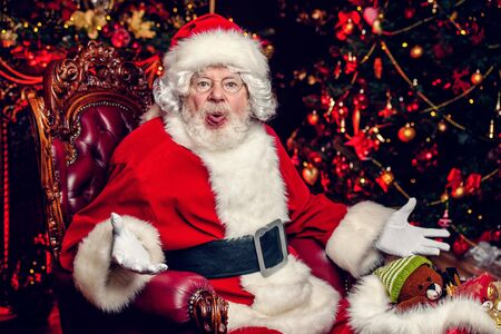 A portrait of funny Santa Claus. Miracle time. Merry Christmas and Happy New Year.