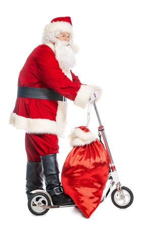 A portrait of Santa Claus with a scooter and bag gifts.