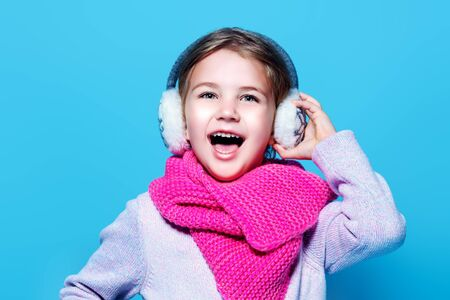 A portrait of a cute pretty girl posing in studio. Beauty, autumn and winter fashion for kids. Standard-Bild - 134131380