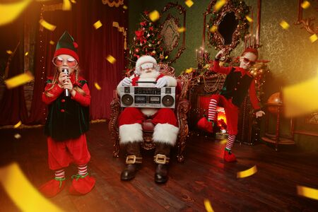 Christmas party with Santa Claus and little elves. Merry Christmas and Happy New Year! Reklamní fotografie