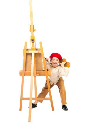A full length portrait of a funny girl painting a picture. Creativity, artist.