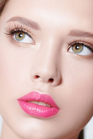 Healthcare and beauty concept. Close-up portrait of a beautiful young woman with fresh healthy shining skin. Facial skin care, cosmetology.