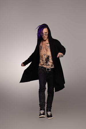 Full length portrait of a punk rock musician posing at studio. Youth alternative culture. Foto de archivo