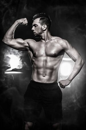 Portrait of a handsome athletic man with perfect muscular body. Bodybuilding concept. Healthy lifestyle.