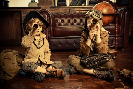 Two boys are playing at home to travelers. Childhood. Fantasy, imagination.