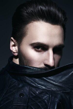 Mens fashion. Portrait of a handsome man in black leather jacket. Studio portrait. Zdjęcie Seryjne