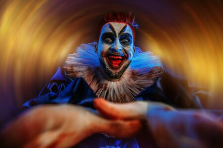 A portrait of an angry crazy clown from a horror film. Halloween, carnival. 版權商用圖片
