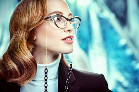 Modern business woman in formal clothes and spectacles. Beauty, fashion. Optics and eyewear style. Close-up portrait.