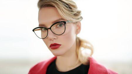Close-up portrait of elegant business lady in glasses. Beauty, fashion. Optics and eyewear style.